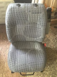 CSG Trimmimg Ford Transit chair recover with OEM fabric